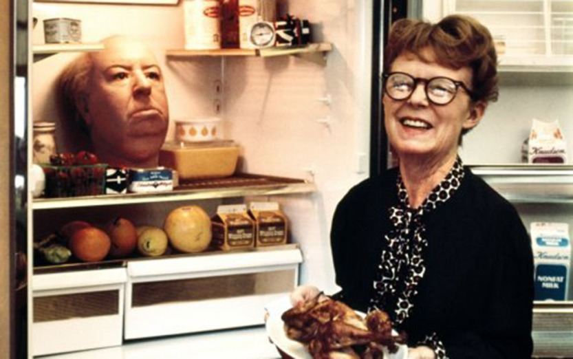 Alfred Hitchcock_s wife Alma Reville with his head in the refrigerator (1974)